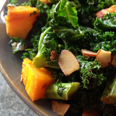 kale and pumpkin stirfry with flaked almonds